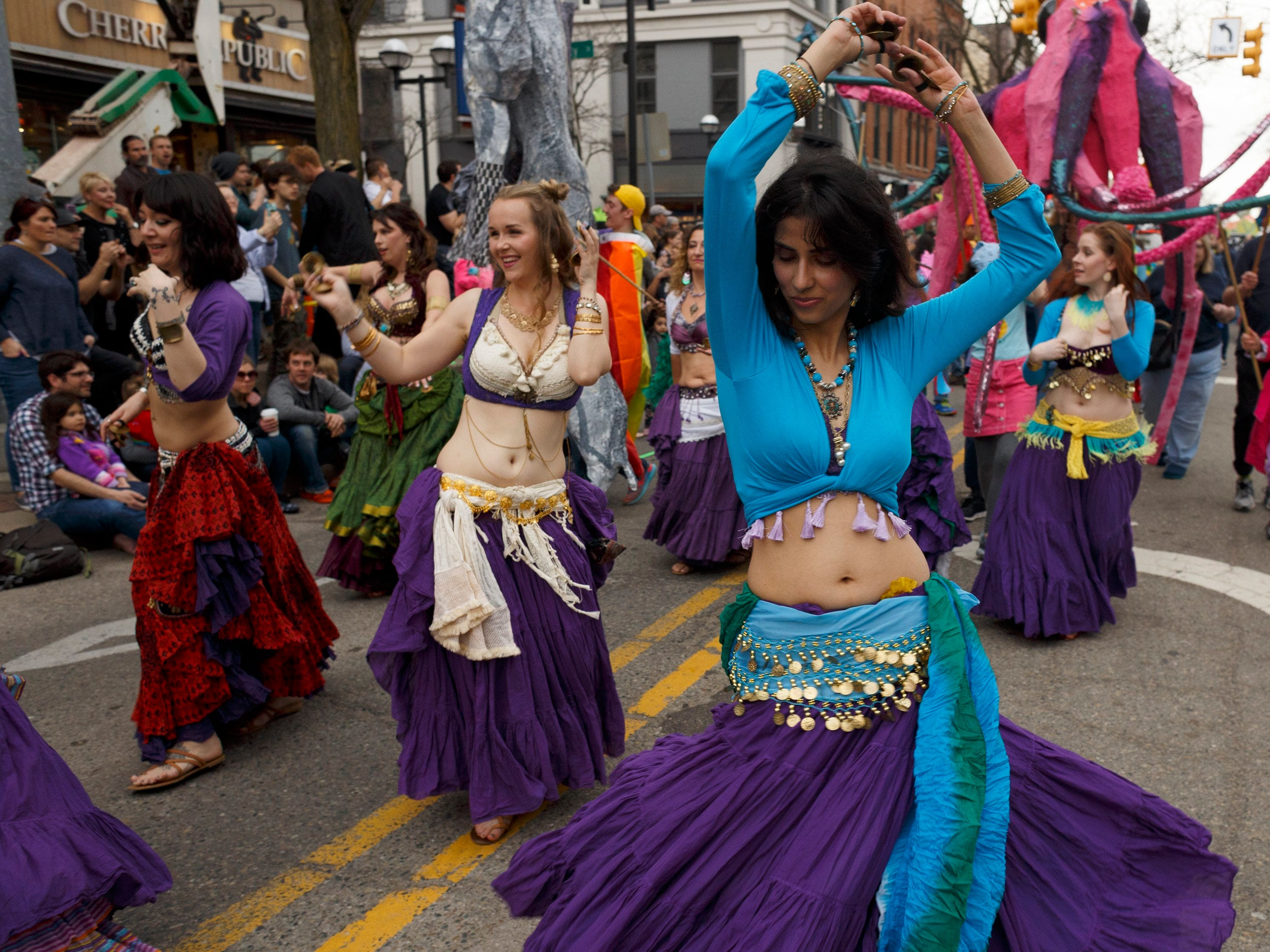 Belly dancers make their way down South Main Street during the annual FestiFools parade on Sunday, April 7, 2019 in downtown Ann Arbor.