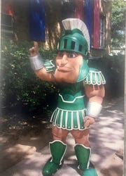Dave Russell, 55, of Hastings, posing in his Sparty outfit for the first time during a fitting in 1989 in Atlanta.
