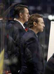 Red Wings GM Ken Holland and team vice president Steve Yzerman, right, watch the team during their game day morning skate before Game 4 against the Nashville Predators in Nashville, Tenn., on Tuesday, April 15, 2008.