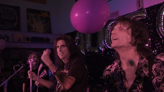 "Alice Cooper (center) and Dennis Dunaway perform at Go Records in Dallas on Oct. 6, 2015, in a scene from ""Live from the Astroturf."""