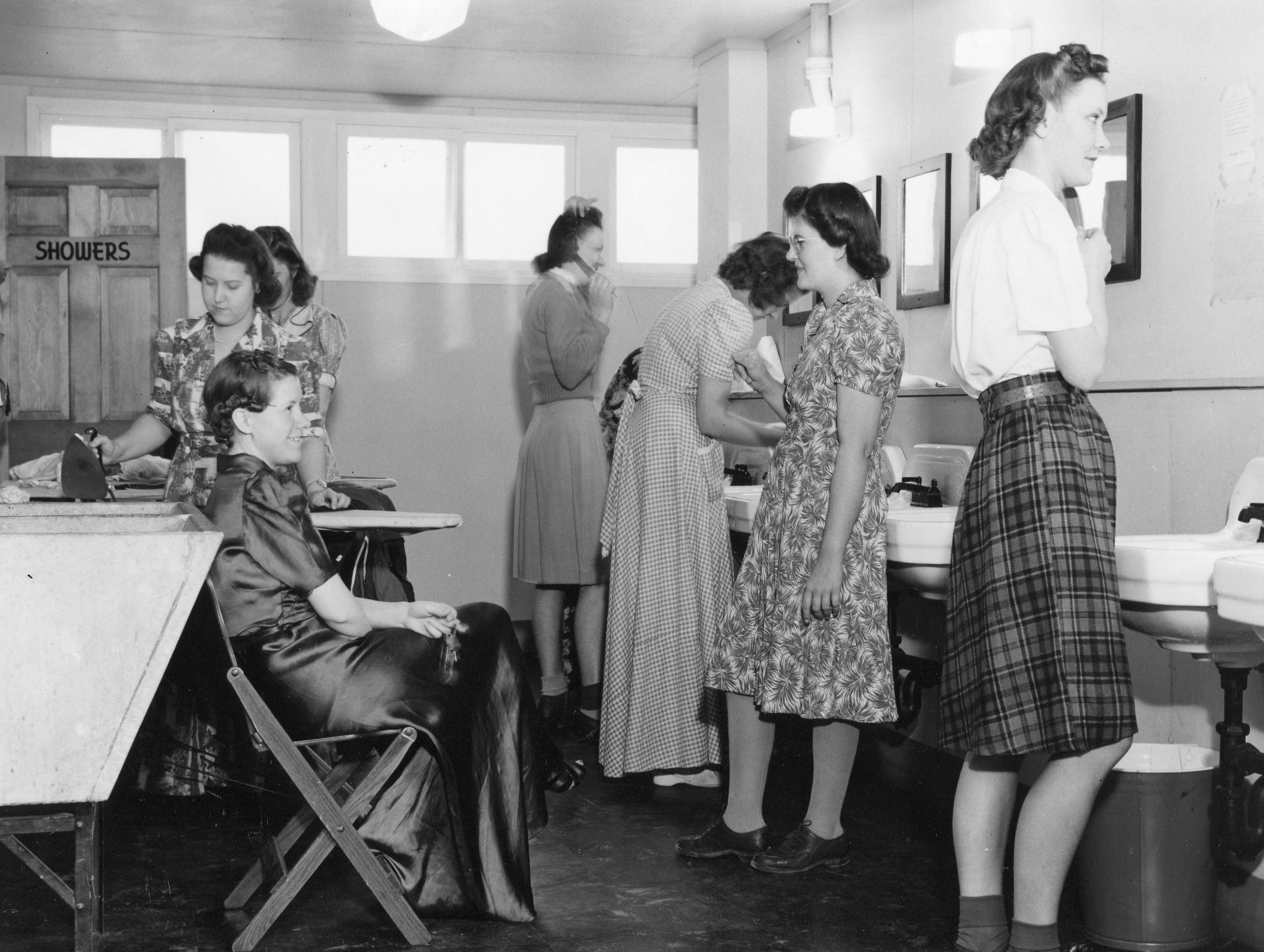 Willow Run, the aircraft manufacturing plant near Ypsilanti, was more than just a workplace.  It had temporary housing for thousands of workers. The women above use the washroom at West Lodge, a dormitory with 1,960 rooms, on Oct. 6, 1944.