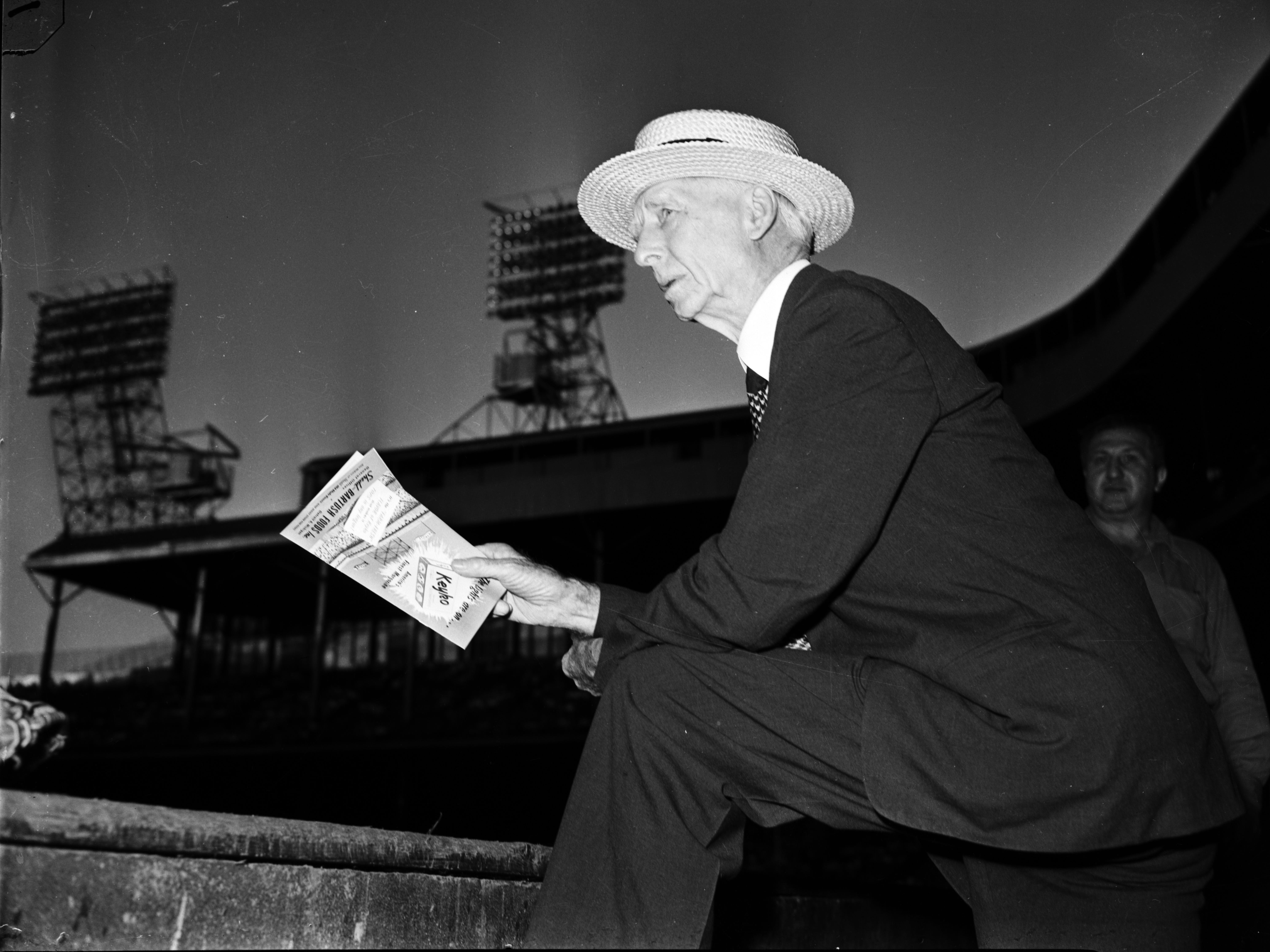 Connie Mack, manager of the Philadelphia Athletics, looks out from the dugout at Briggs Stadium.  In 1944, Mack was in year 43 of managing the A's. He would retire at age 87 after the 1950 season.