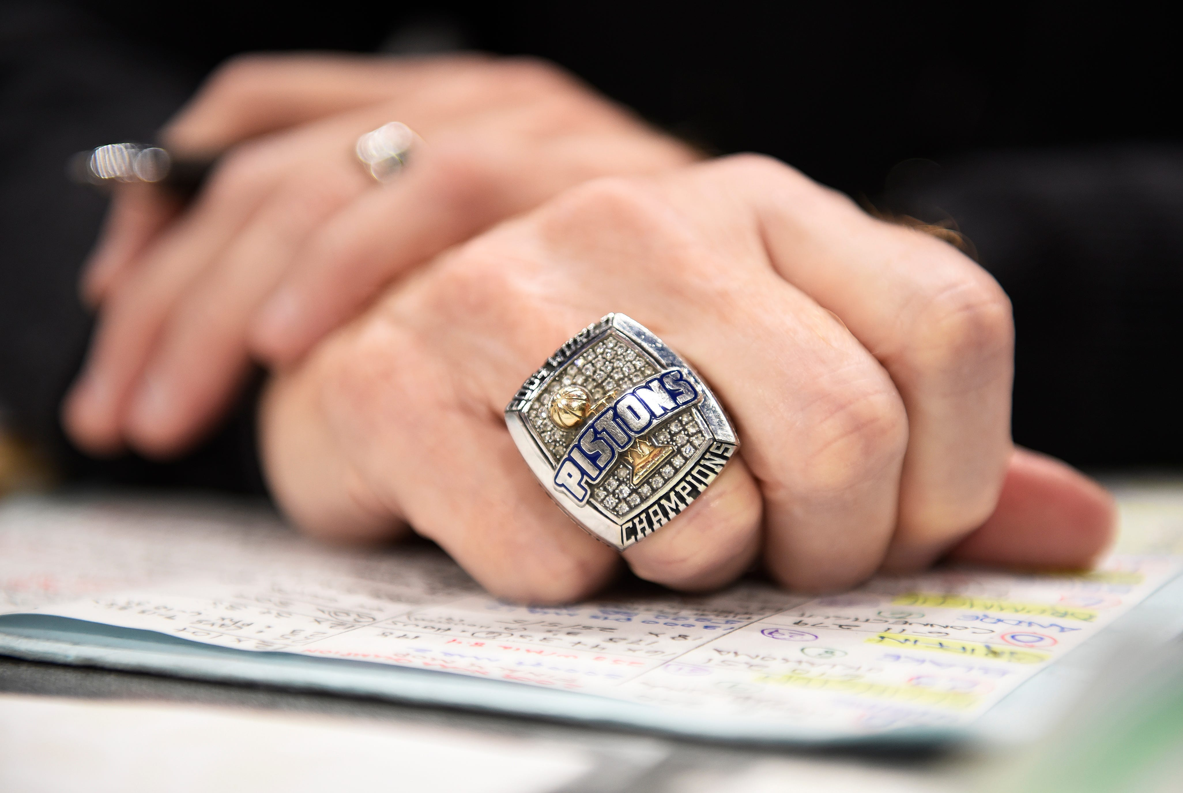 Pistons radio play-by-play man Mark Champion wears his 2004 championship ring.