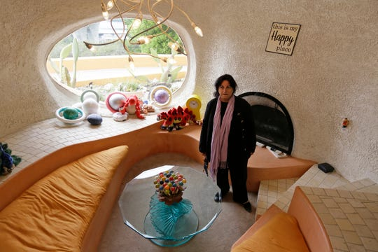 "Attorney Angela Alioto looks over a sunken room called ""The Happy Place,"" inside the Flintstone House in Hillsborough, Calif."