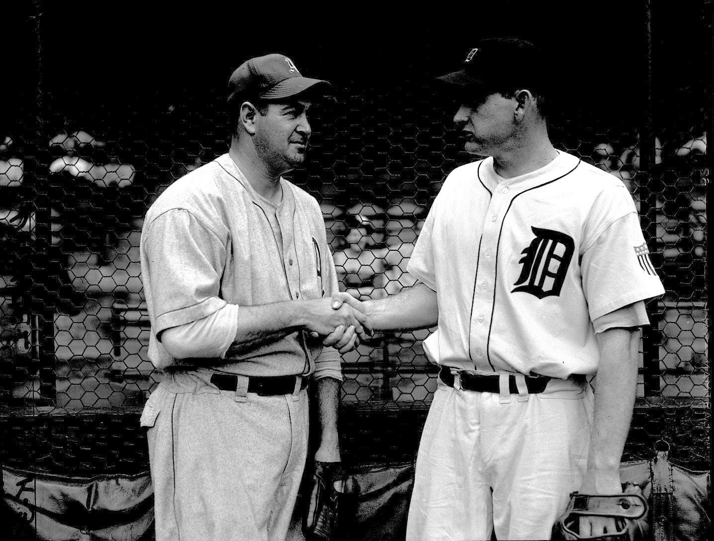 "Paul ""Dizzy"" Trout of the Detroit Tigers, right, shakes hands with Louis ""Bobo"" Newsom of the Philadelphia Athletics before a game. The two pitchers were teammates on the Tigers from 1939-41."