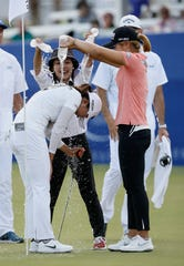 Jin Young Ko, left, is doused by her agent Soo Jin Choi, rear, and golfer Jeongeun Lee6 after winning the LPGA Tour ANA Inspiration.