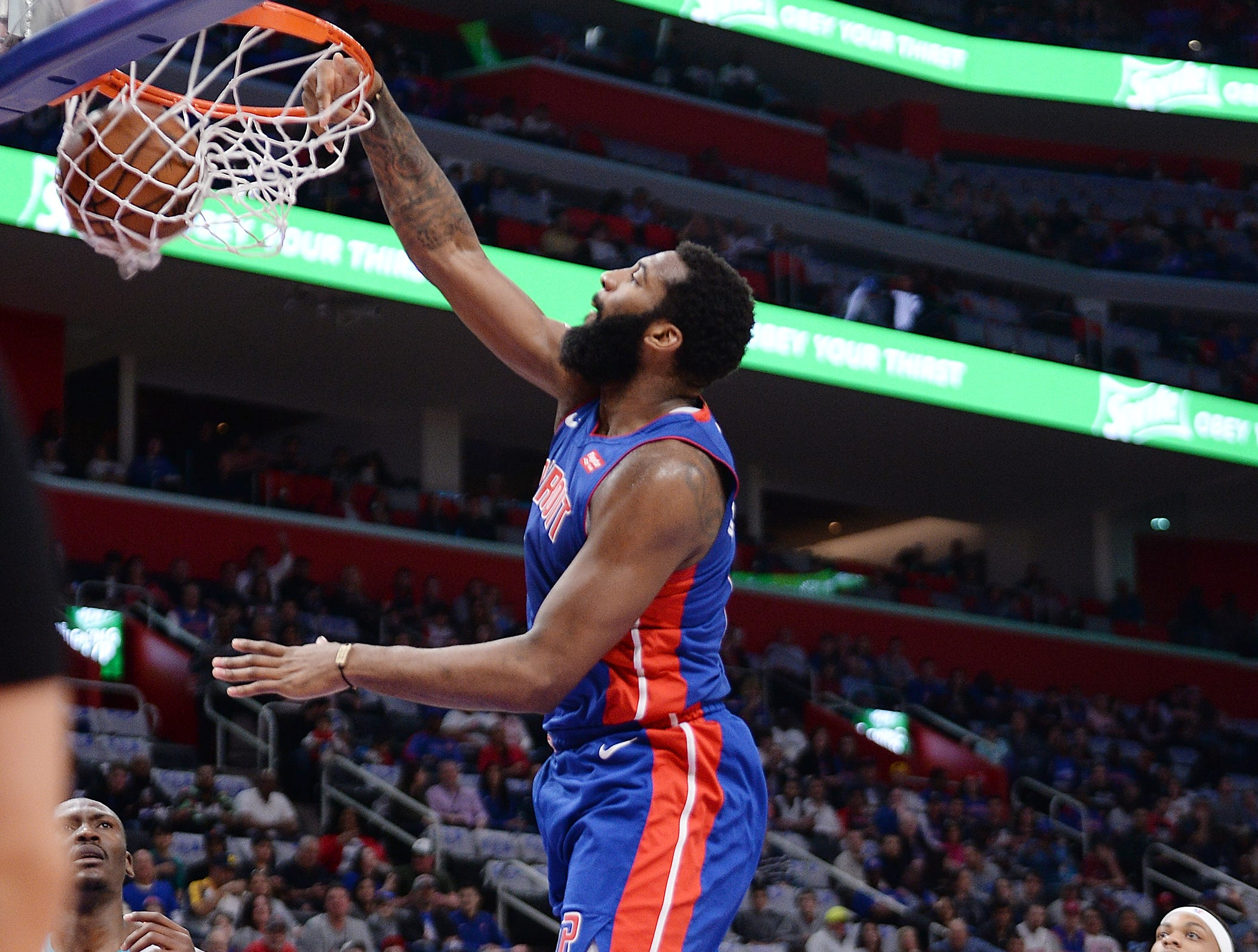 Pistons' Andre Drummond dunks over Hornets' Bismack Biyombo in the first quarter.