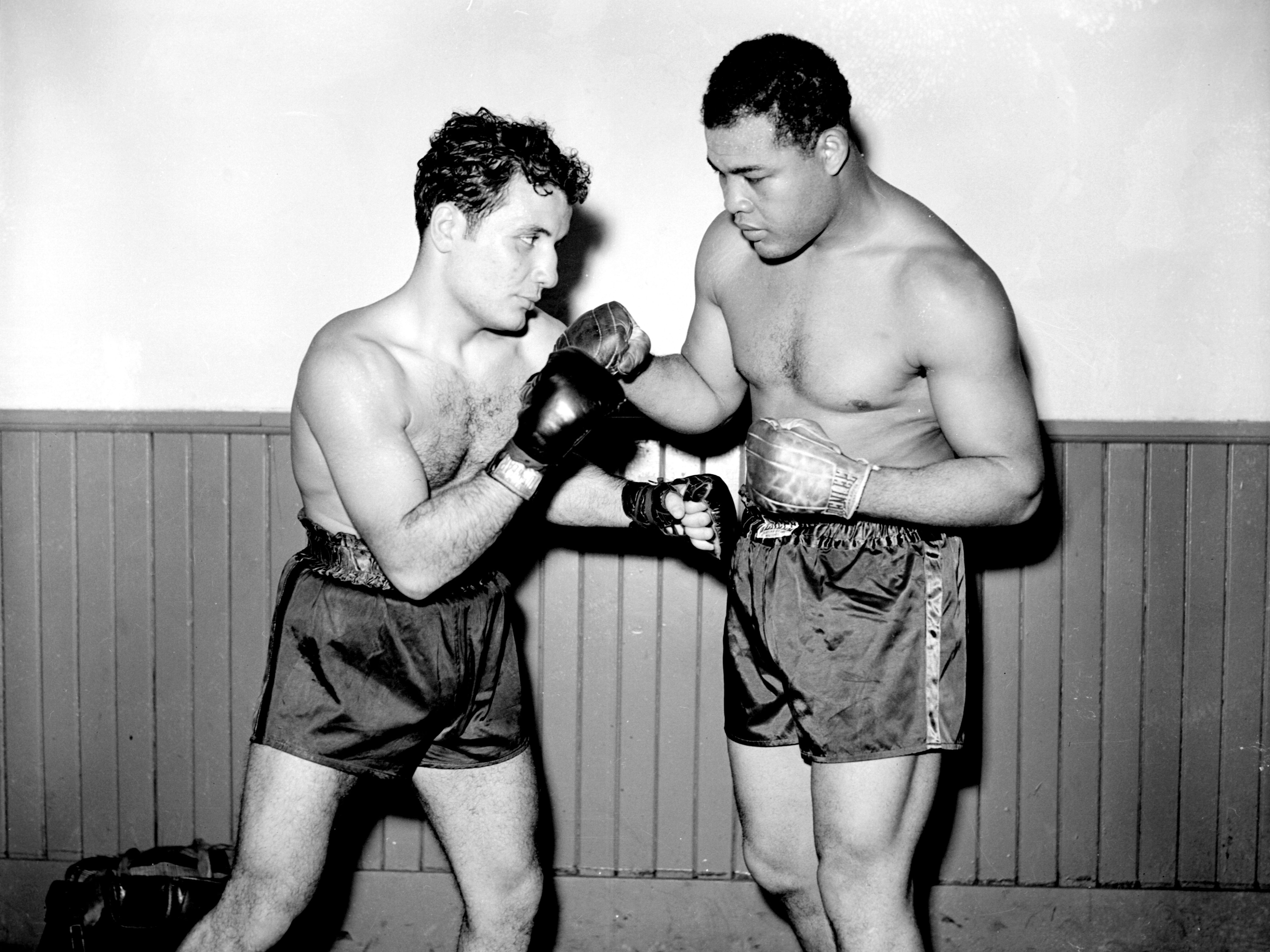 Raging Bull meets Brown Bomber: Middleweight boxing champion Jake La Motta poses with heavyweight champ Joe Louis. On Nov. 3, 1944, they both fought at Olympia Stadium, with Louis knocking out John Denson and La Motta earning a TKO over George Kochan.