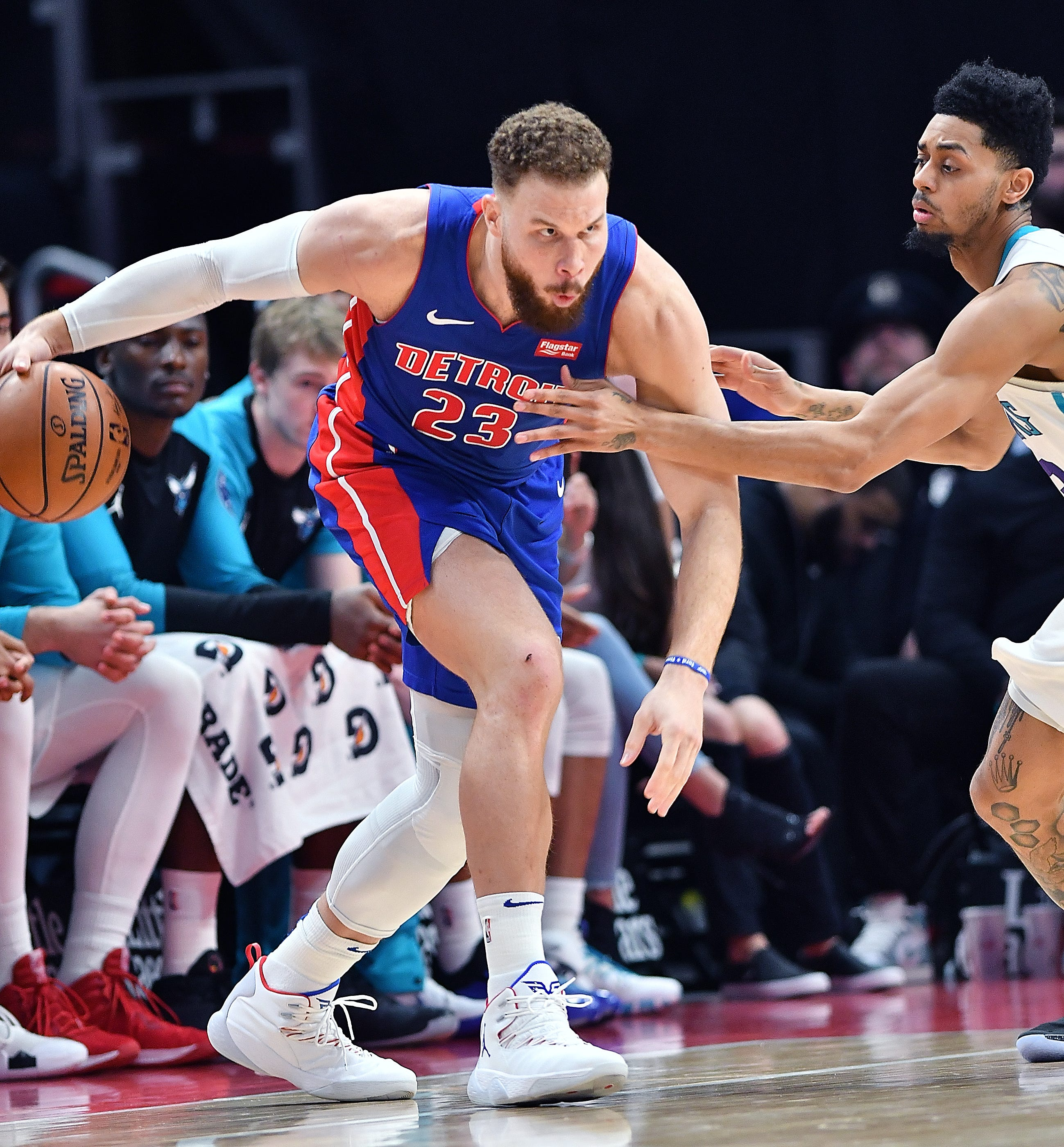 Pistons' Blake Griffin looks for room around Hornets' Jeremy Lamb in the fourth quarter.