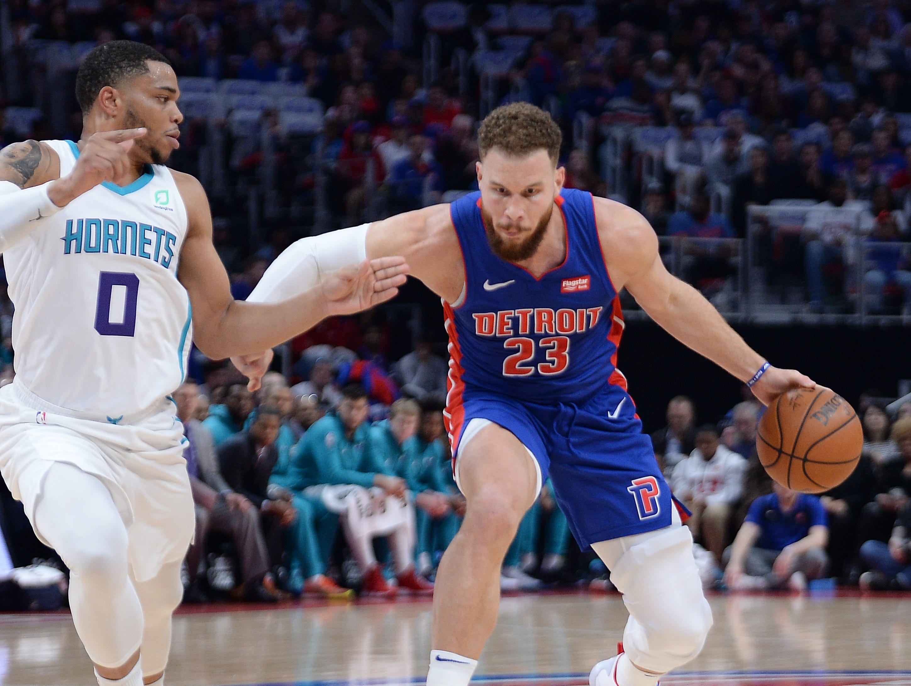 Pistons' Blake Griffin drives around Hornets' Miles Bridges in the first quarter.