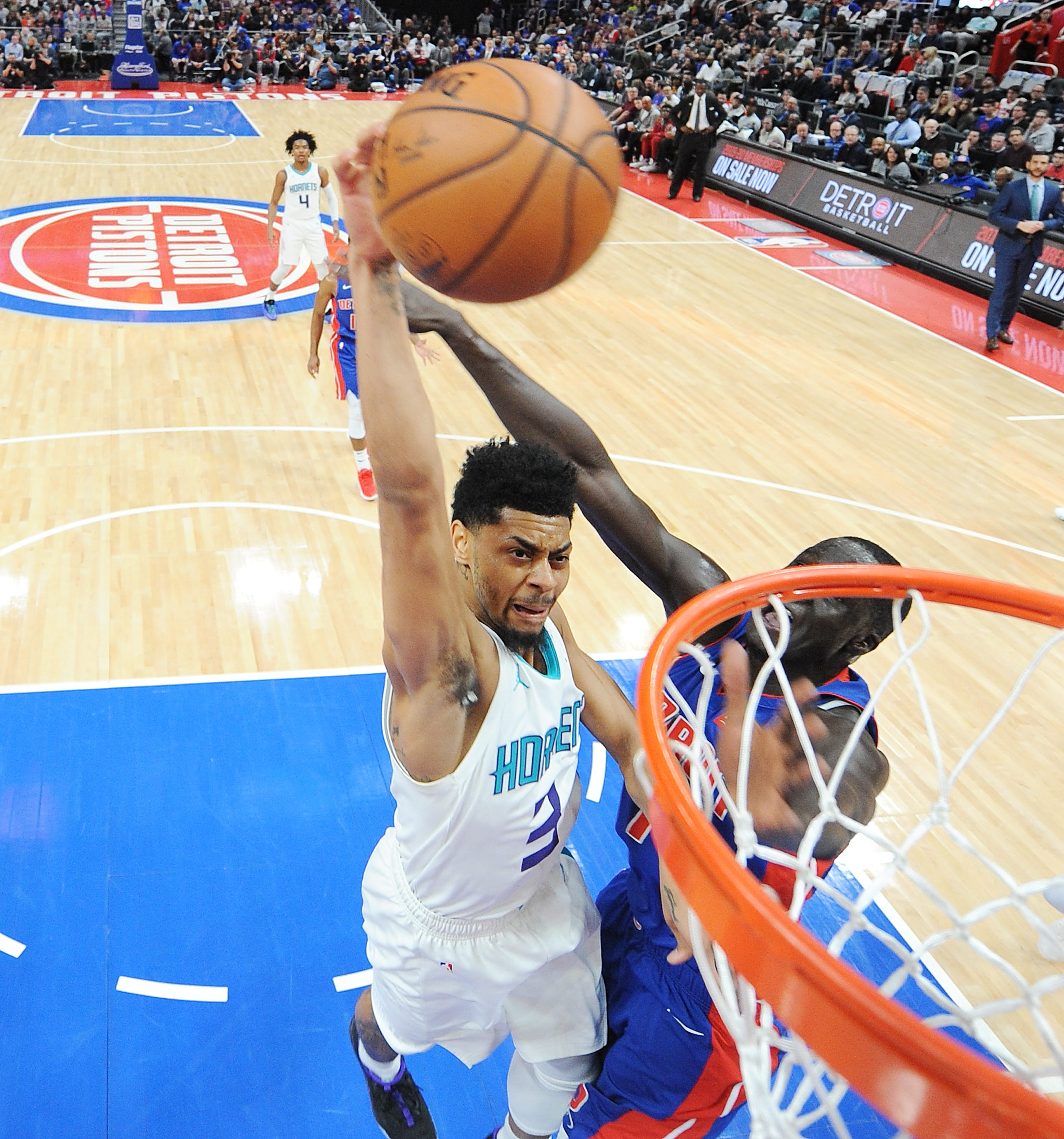 Jeremy Lamb is fouled by Pistons' Thon Maker on his dunk attempt in the second quarter.
