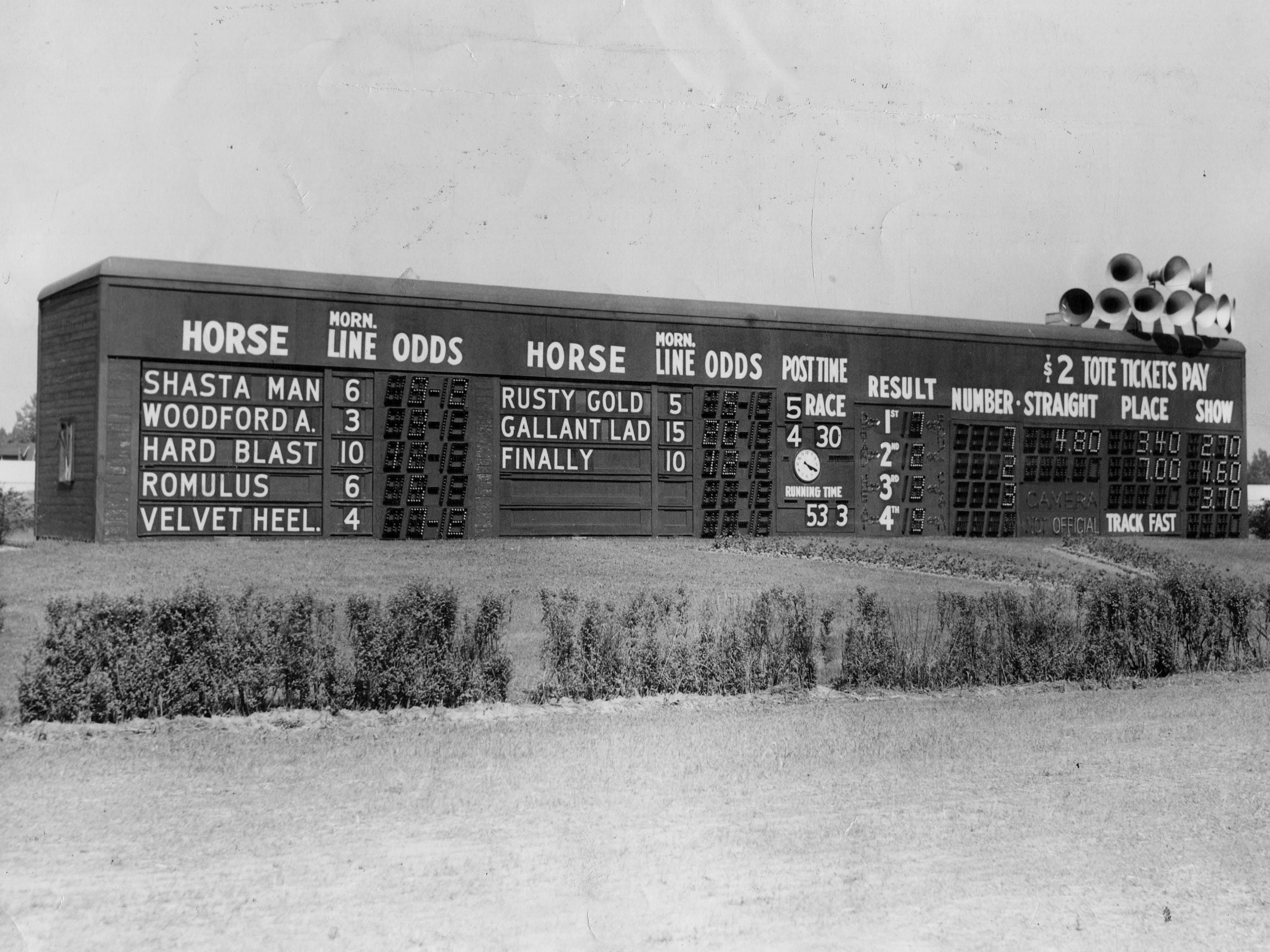 Horses and their morning lines are posted by hand on the scoreboard at this Detroit-area race track in 1944.  The track was not identified, but Northville Race Track had been operating since the turn of the 20th century, and its successor Northville Downs was constructed in 1944.