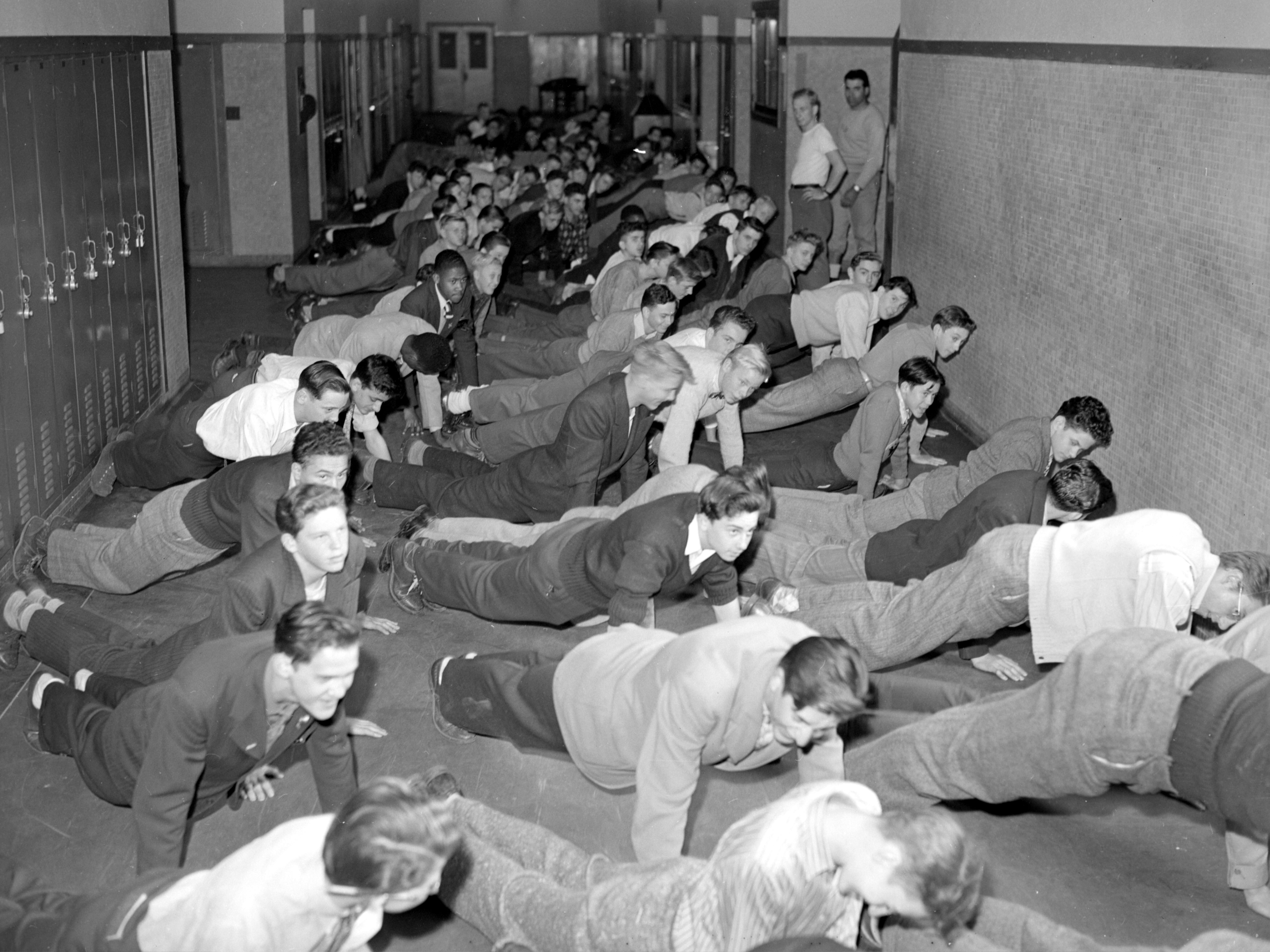 Classroom overcrowding was a big problem in Detroit in 1944. The boys at Pershing High exercise in the school hallways, since there was no gymnasium. The high school had a capacity of 1,666, but an enrollment of nearly 3,800.