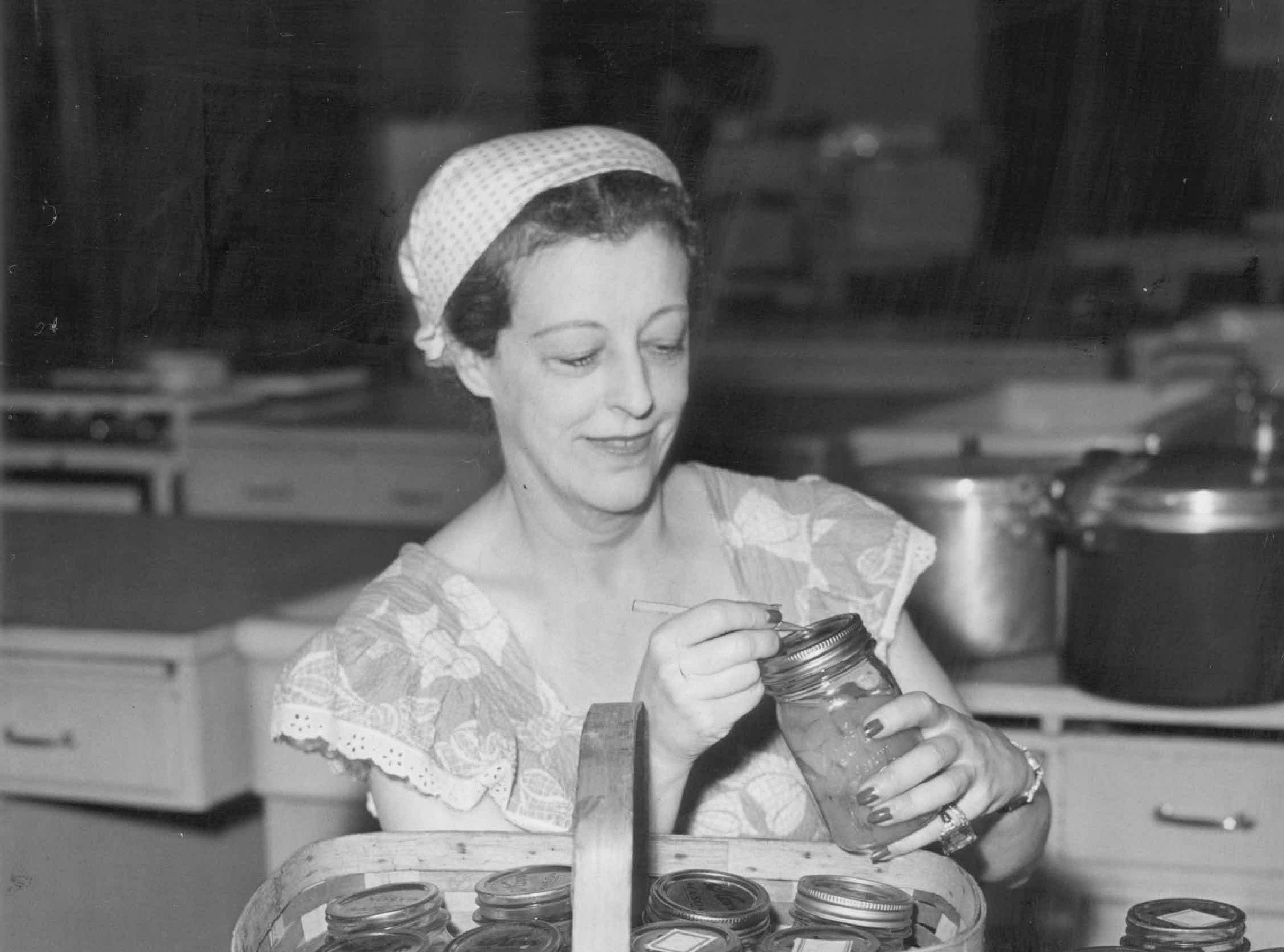 Countess Gwendolyn Currie Tolstoi, notable in Detroit society in 1944, marks some jars of canned food. Her husband, Count Cyril Tolstoi, was a cousin of Russian novelist Leo Tolstoy.
