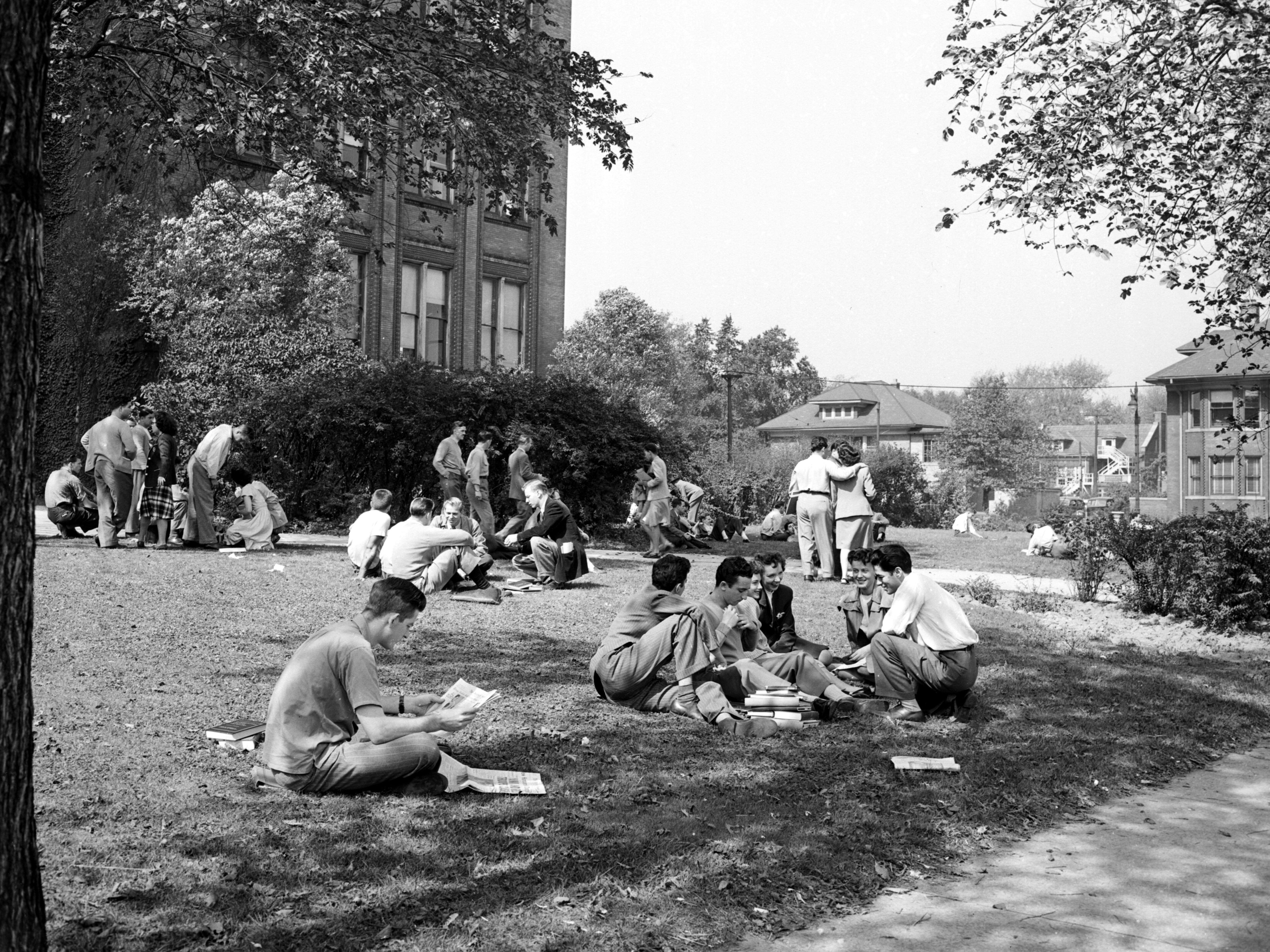 Wayne University students relax on the lawn in Detroit on Aug. 27, 1944. The institution was renamed Wayne State University in 1956.
