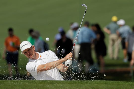 Justin Rose hits out of the bunker on the seventh green during a practice round Monday.