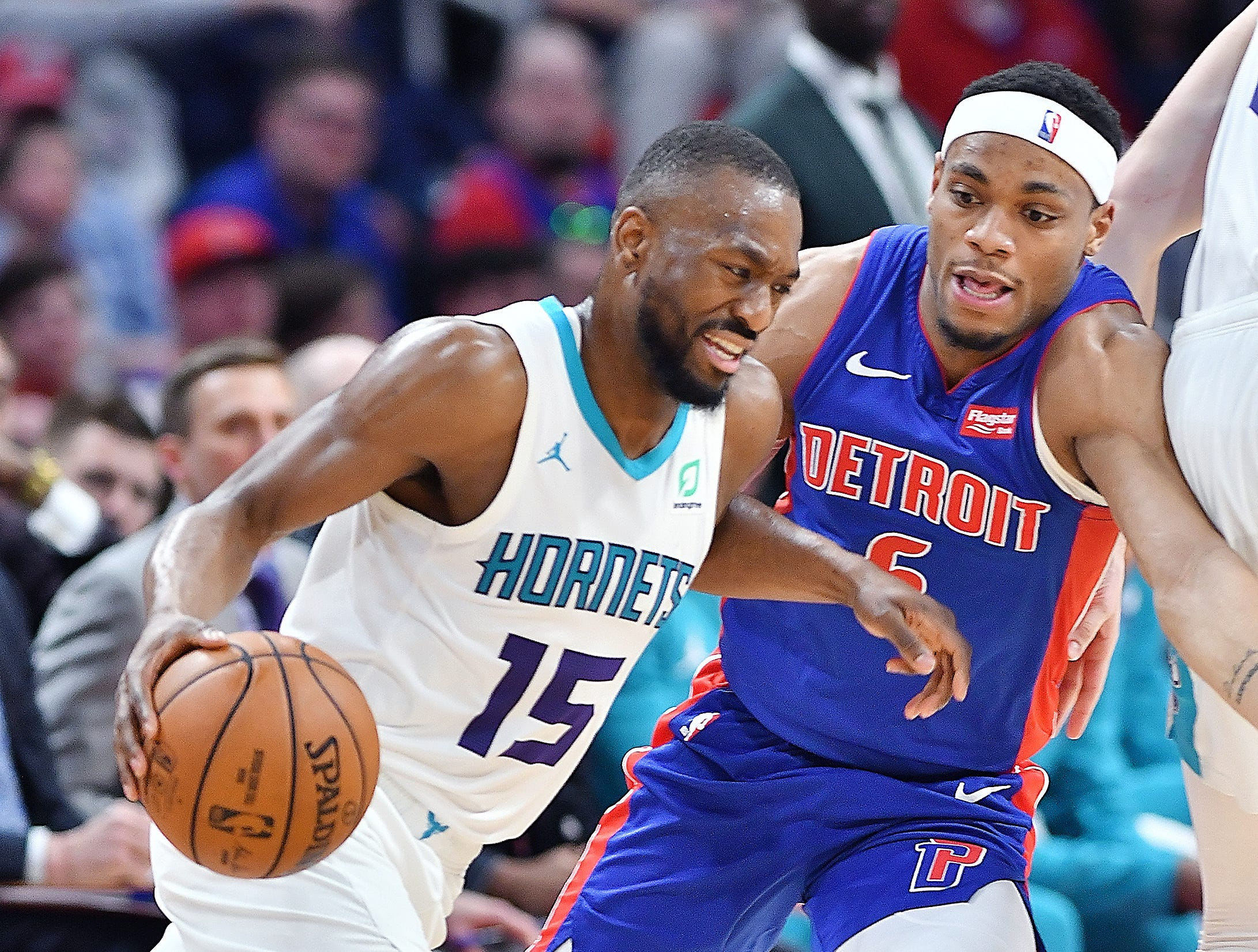 Hornets' Kemba Walker drives around Pistons' Bruce Brown in the second quarter.