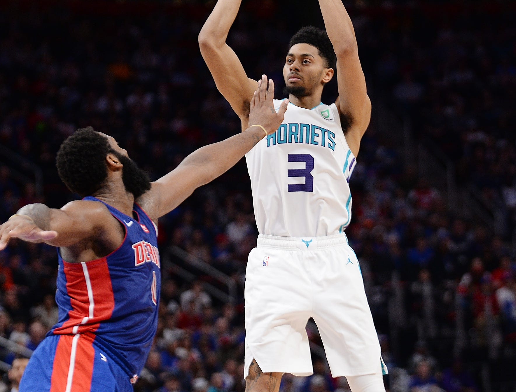 Hornets' Jeremy Lamb scores over Pistons' Andre Drummond in the fourth quarter.