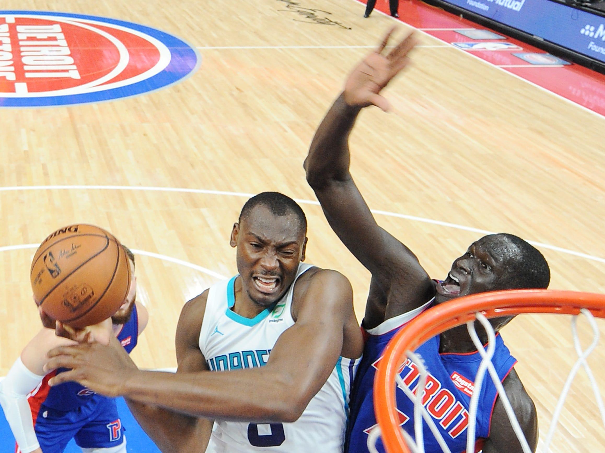 Hornets' Bismack Biyombo shoots over Pistons' Thon Maker in the second quarter.