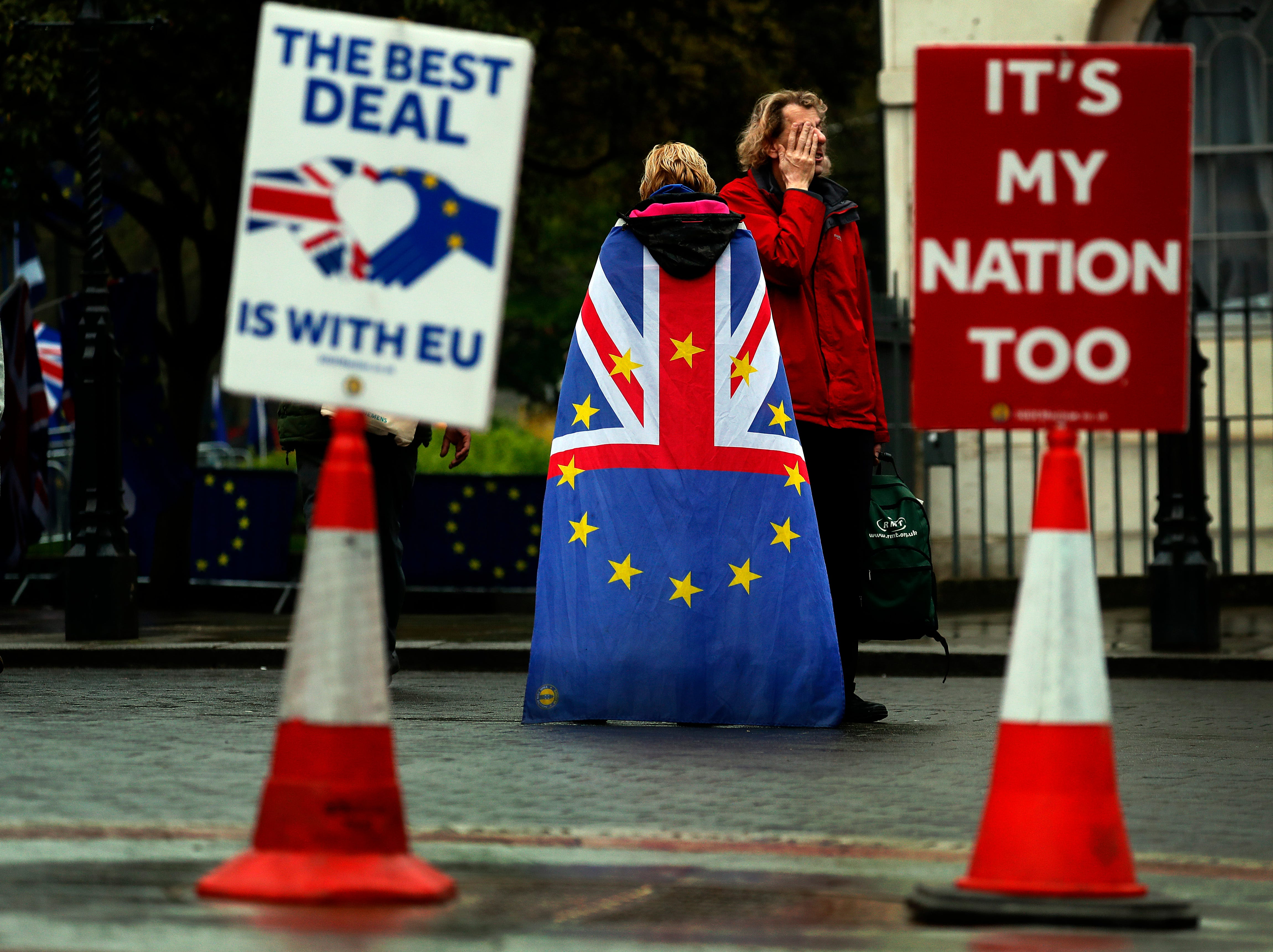 People opposed to Brexit demonstrate opposite the Houses of Parliament in London, Monday, April 8, 2019. Britain's Prime Minister Theresa May will hold talks with the leaders of Germany and France ahead of a key Brexit summit later this week.