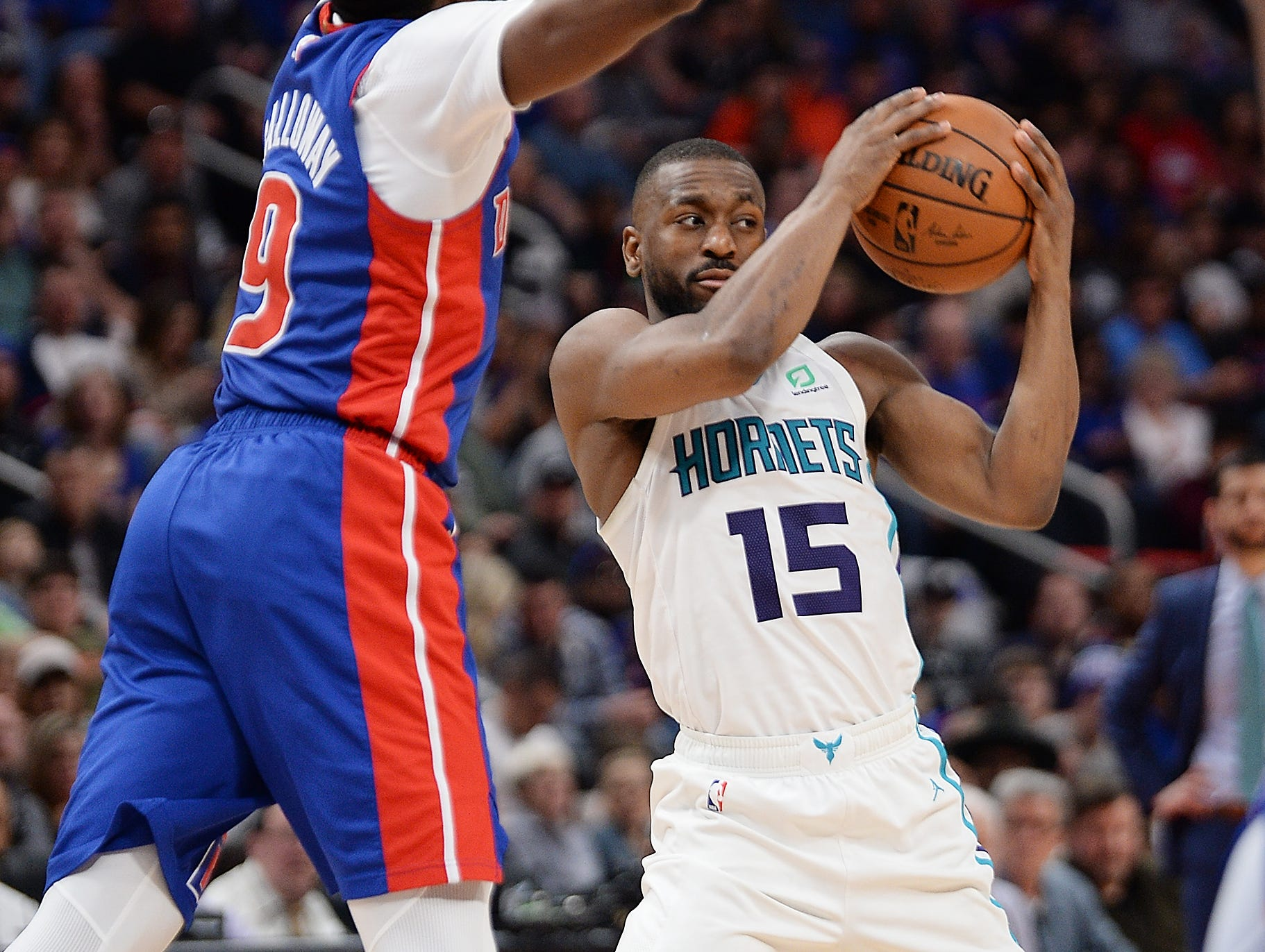 Hornets' Kemba Walker looks for room around Pistons' Langston Galloway in the fourth quarter. Walker had a game high 31 points and 7 assists.