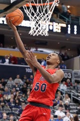 Eric Williams Jr., a former New Haven star who was Duquesne's leading scorer and rebounder as a sophomore, says he's transferring.