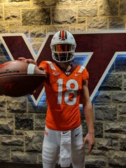 Gibson Southern freshman Brady Allen poses in a Virginia Tech football uniform while on a recent recruiting visit.