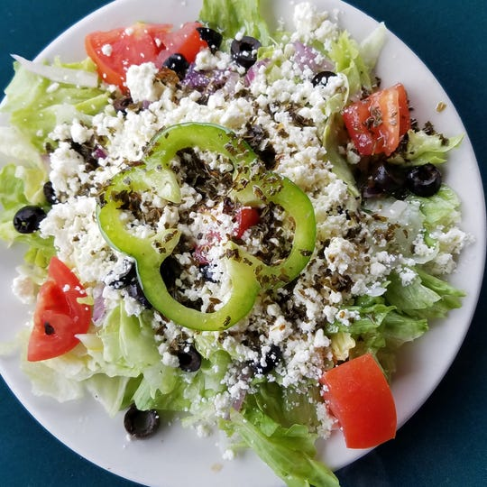A small Greek salad with mint dressing and extra cheese from the Deerhead Sidewalk Cafe and Bar.