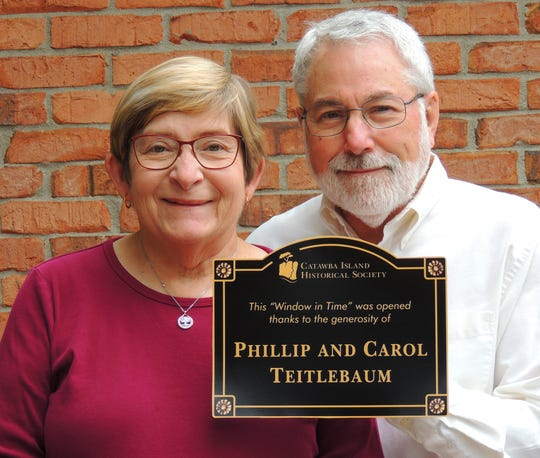 Doctors Phillip and Carol Teitlebaum get Catawba Island Historical Society sponsorship program off to healthy start.