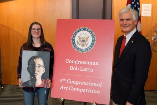 Jordyn Gears, left, stands with Congressman Bob Latta.