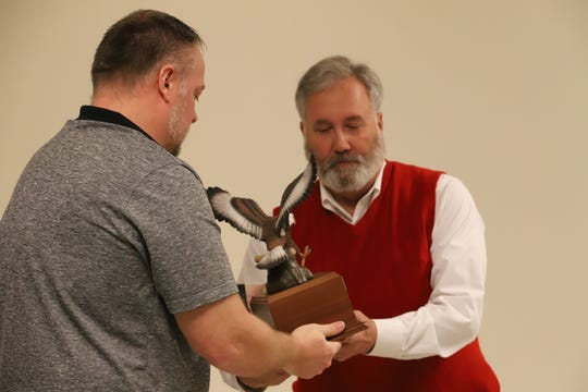 Dean Auxter received his 40-year service award for his time with the Clyde Fire Department from Clyde Fire Chief Craig Davis.