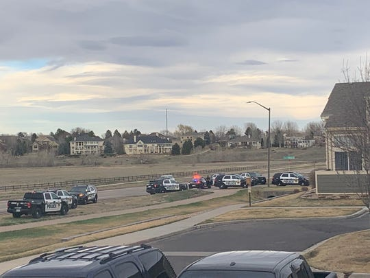 Police respond to the report of a barricaded person with a gun in southeast Fort Collins on Sunday.
