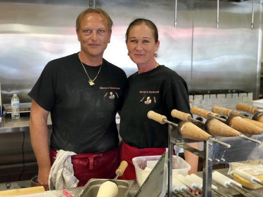 Gerald and Sonja Schimpl are Austrian. But they say their concept, Hungarian-style firebreads filled with unique toppings, is all-American.