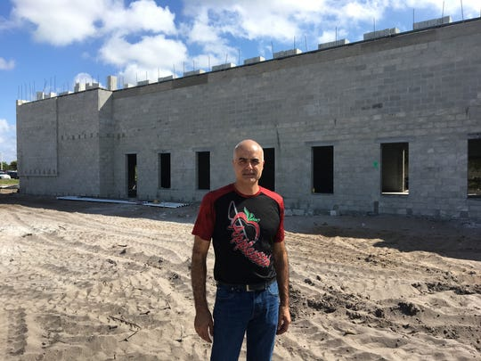Luca Mele, owner of Apple Stitch embroidery and screen printing, stands in front of his new store under construction at 413 NE Van Loon Lane in Cape Coral. Mele bought the land from Billy Fuccillo, whose Fuccillo Kia car dealership is adjacent and off Pine Island Road.