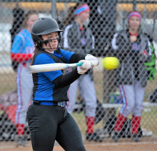 Morgan Durand hits a walk-off double to score the winning run in Oconto's season opener against Southern Door on March 28.
