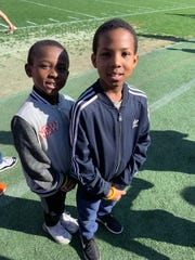 """Tyreke Sizemore, 8, and A'zariah Sizemore, 9, at The All Pro Dad Experience hosted by Clemson University Football Coach Dabo Swinney in February. The brothers were injured in a car wreck while on their way to church Sunday. """"They love Clemson football,"""" their dad, Kam Sizemore, said."""