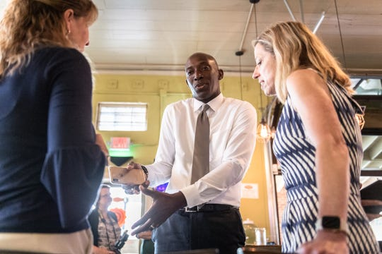 Wayne Messam, mayor of Miramar, Fla., and a 2020 Democratic presidential candidate, speaks with Judi Buckley, once a candidate for South Carolina House of Representatives District 17, and Dorothy Dowe, candidate for Greenville City Council at the Growler Haus in the Village of West Greenville, Apr. 8, 2019.