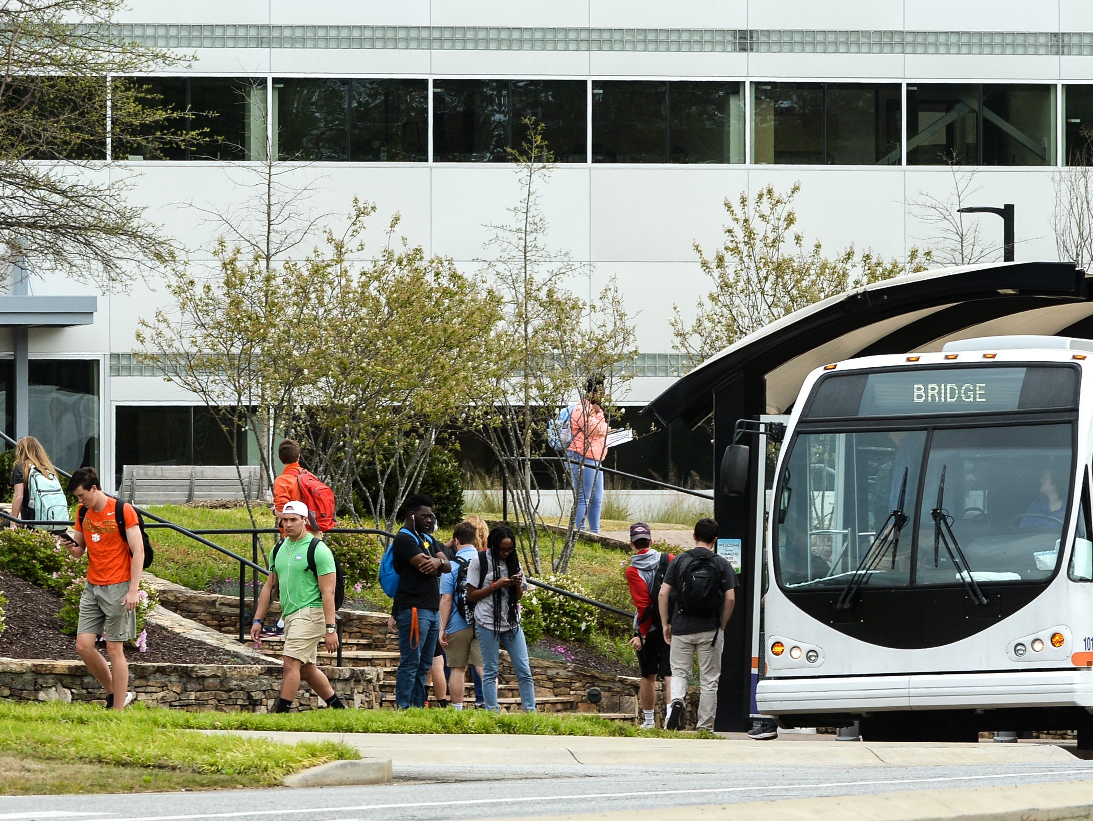 A Tiger Transit bus delivers students in the Bridge to Clemson program from Clemson campus to their classes in Pendleton at Tri-County Technical College Monday.