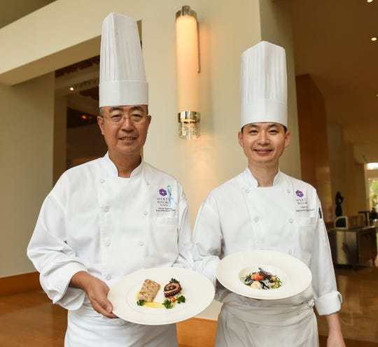 Hyatt Regency Guam Executive Sous Chefs Kenny Homma, left, and Tony Lee hold some of their new dishes at the Hyatt Regency Guam in Tumon, April 5, 2019.