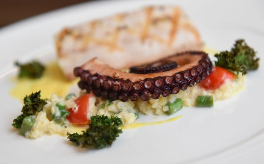 A grilled cobia, quinoa-long bean, crispy kale, saffron sauce and octopus dish from Ristorante Al Dente at the Hyatt Regency Guam in Tumon, April 5, 2019.