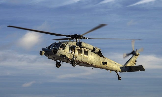 An MH-60S Sea Hawk helicopter assigned to the Island Knights of Helicopter Sea Combat Squadron 25 conducts a training flight at Andersen Air Force Base in this 2016 file photo.