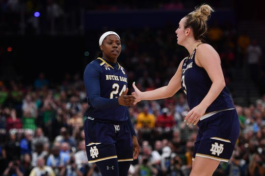 Apr 7, 2019; Tampa, FL, USA; Notre Dame Fighting Irish guard Arike Ogunbowale (24) celebrates with Notre Dame Fighting Irish guard Marina Mabrey (3) against the Baylor Lady Bears during the second half in the championship game of the women's Final Four of the 2019 NCAA Tournament at Amalie Arena.