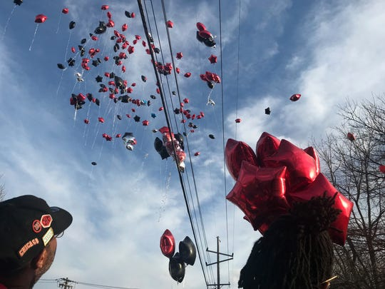 Attendees of the vigil released balloons in red and black, Leandre's favorite colors.