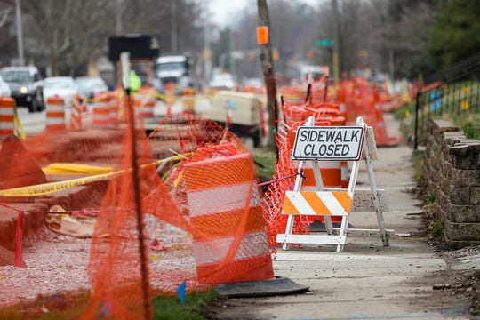 Red Line construction, including a closed sidewalk near Taste CafŽ and Marketplace, is seen at College Avenue and 52nd Street in South Broad Ripple in Indianapolis on Friday, April 5, 2019. Many owners along the Red Line construction route attribute a decrease in business to lack of parking, increased traffic and difficulty navigating around road work areas.