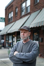 Owner Scott Goodwine stands in front of the College Arms Building at 52nd Street and College Avenue in South Broad Ripple on Friday, April 5, 2019. Goodwine is one of several owners in the area who has expressed concern over how Red Line construction is negatively impacting business due to lack of parking, increased traffic and difficulty navigating road work areas.