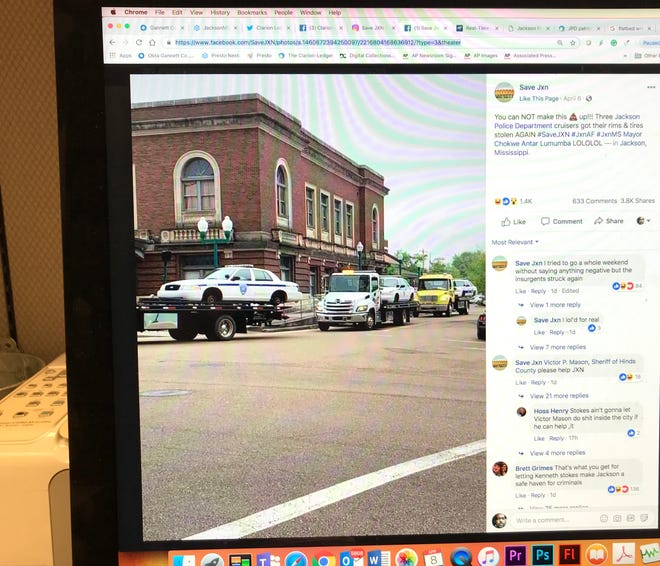 This photo of a computer screen shows Jackson police cars on the back of flatbed tow trucks pictured in a social media post.
