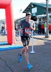 Kurt Lodico crosses the finish line of the Andrew Jackson Marathon on Saturday. Lodico ran the marathon in Jackson even though he lives in north Illinois.