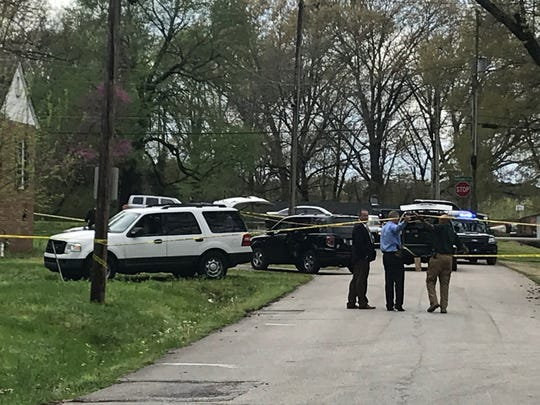 Jackson Police Chief Julien Wiser lifts the crime scene tape at the site of a shooting now being investigated as a homicide. Police responded to a residence near the intersection of Hollywood Drive and Sherrill Drive in Jackson at around 3 p.m. Monday.