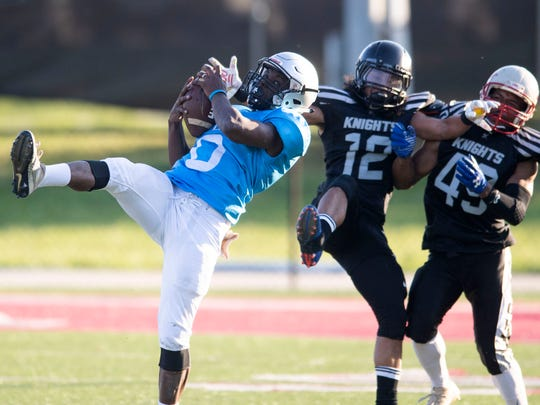 """Isaiah Wright pulls pulls down the ball on a catch during a game against the East Tennessee Knights. Wright, a running back featured on the Netflix series """"Last Chance U, is playing semipro football for the Alcoa Alloys on Saturday, April 6, 2019."""