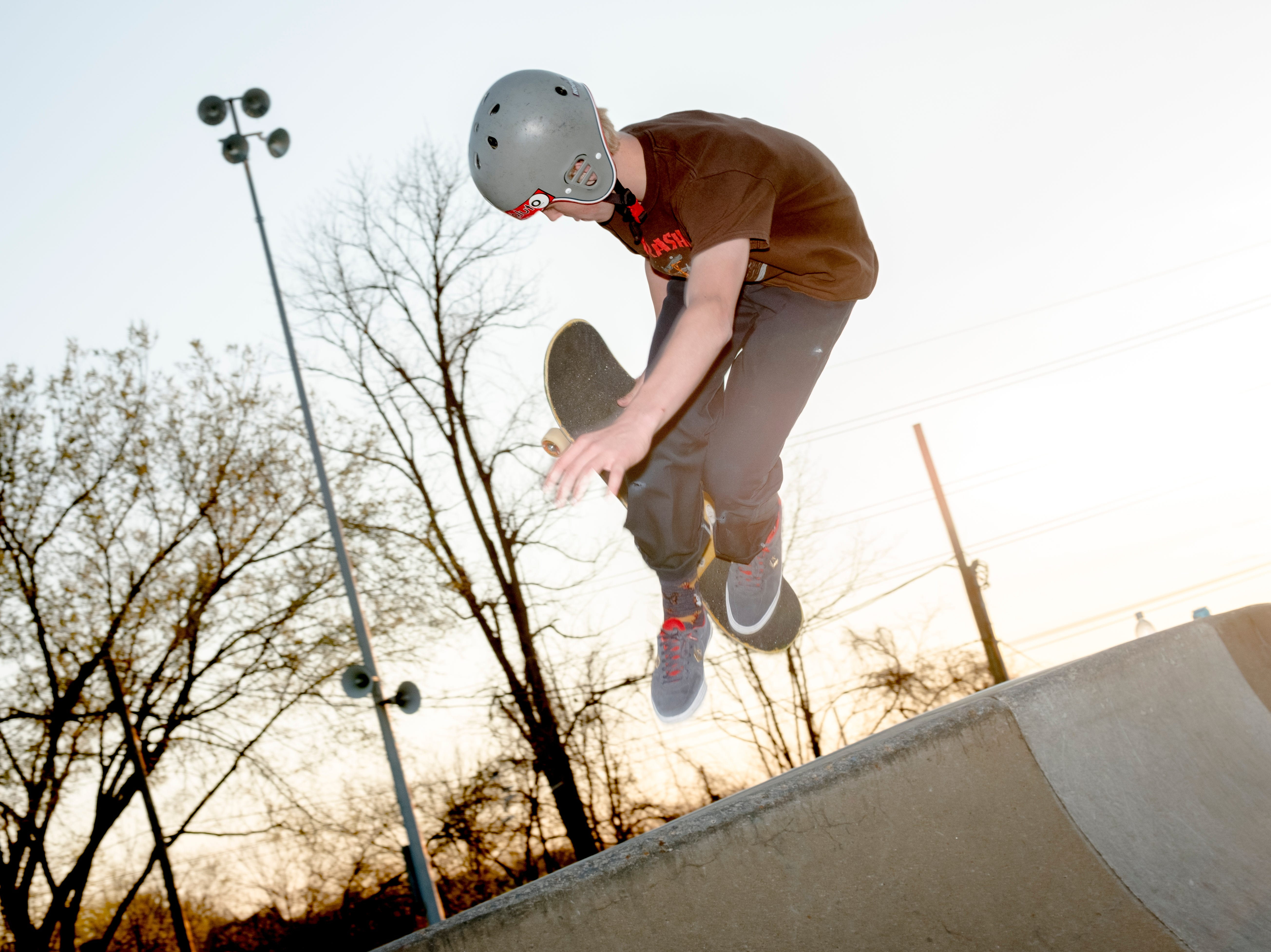 "James Cassell, a sophomore at L&N STEM Academy, does a trick while skateboarding at the Knoxville Skatepark in Knoxville, Tennessee on Tuesday, April 2, 2019. Cassell has been boarding for two and a half years after watching his older brother skateboard. His favorite part about it? Landing new tricks is the ""best feeling in the world,"" he said."